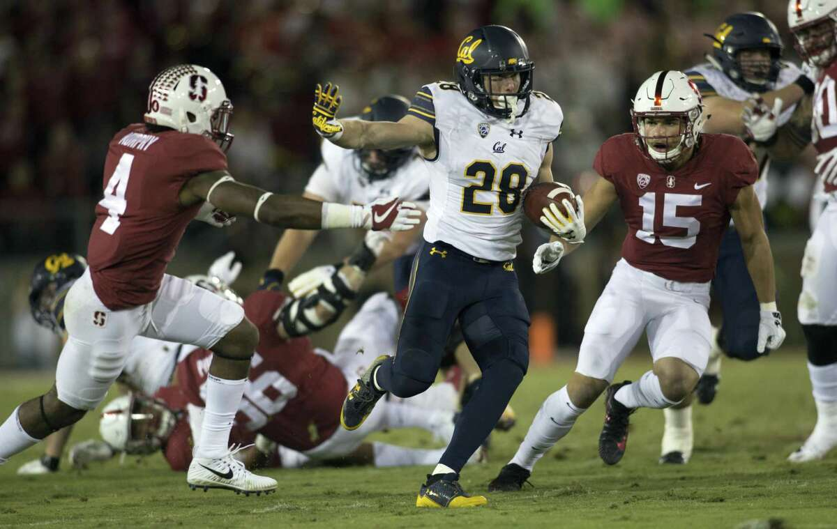 California?'s Patrick Laird (28) runs between Stanford?'s Alameen Murphy (4) and Jordan Perez (15) during the second quarter the 120th Big Game, Saturday, Nov. 18, 2017 in Stanford, Calif.