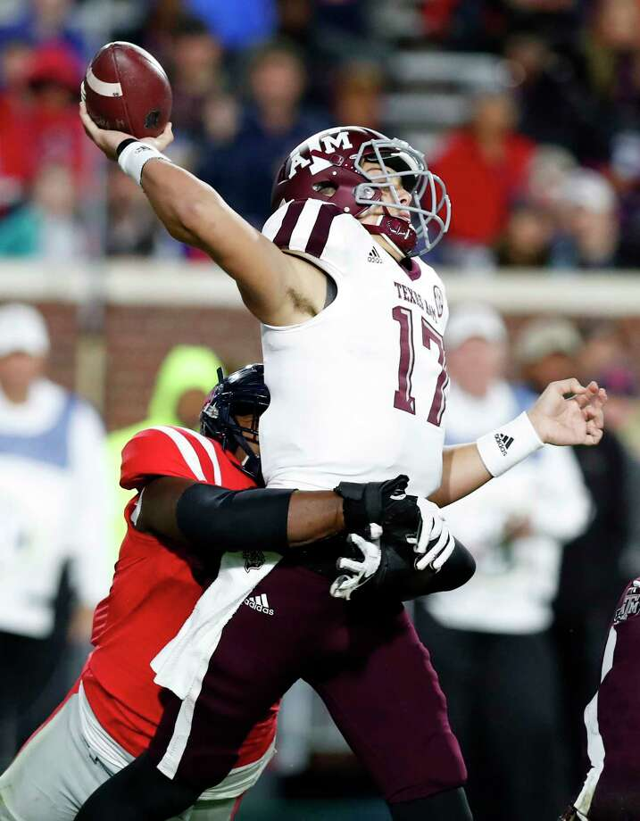 Texas A&M quarterback Nick Starkel (17) is hit by a Mississippi defender as he attempts a pass during the first half of an NCAA college football game in Oxford, Miss., Saturday, Nov. 18, 2017. The pass was incomplete. (AP Photo/Rogelio V. Solis) Photo: Rogelio V. Solis, STF / Copyright 2017 The Associated Press. All rights reserved.