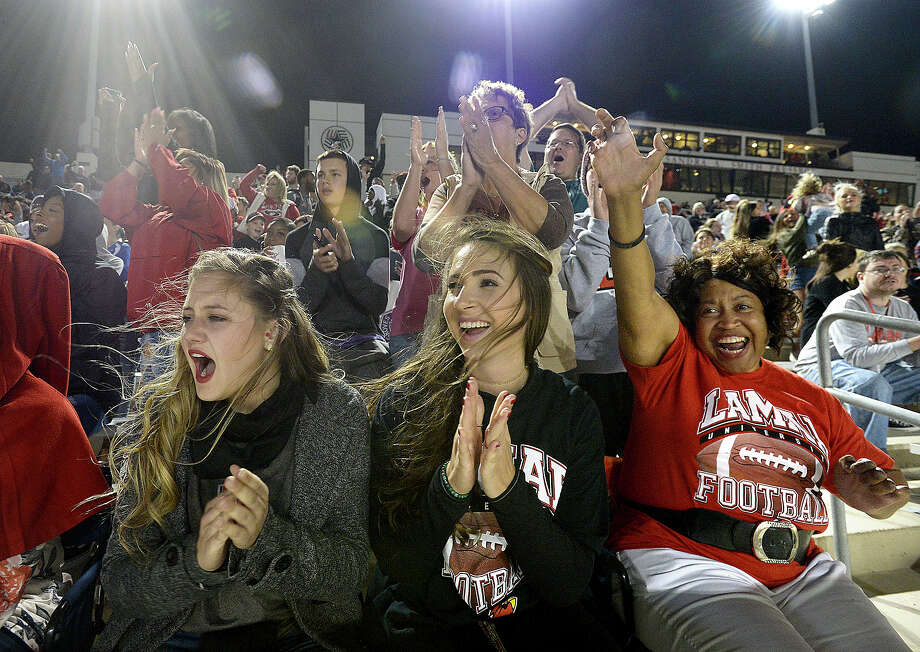 From left, Michele Harrelson, Natalie Ferraro, and Victoria Miles cheer with the crowd as Lamar puts the first points on the board with a touchdown against McNeese State during the Cardinals' final home game at Provost Umphrey Stadium Saturday. Photo taken Saturday, November 18, 2017 Kim Brent/The Enterprise Photo: Kim Brent / BEN