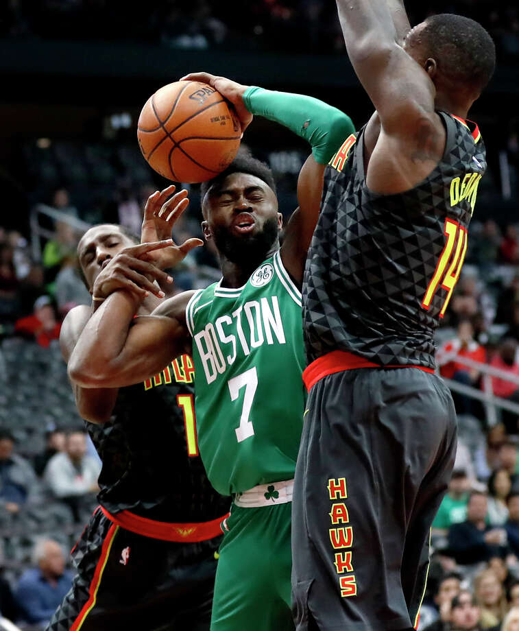 Boston Celtics' Jaylen Brown (7) is fouled by Atlanta Hawks' Taurean Prince, left, in the first quarter of an NBA basketball game in Atlanta, Saturday, Nov. 18, 2017. Boston won 110-99. (AP Photo/David Goldman) ORG XMIT: GADG107 Photo: David Goldman / Copyright 2017 The Associated Press. All rights reserved.