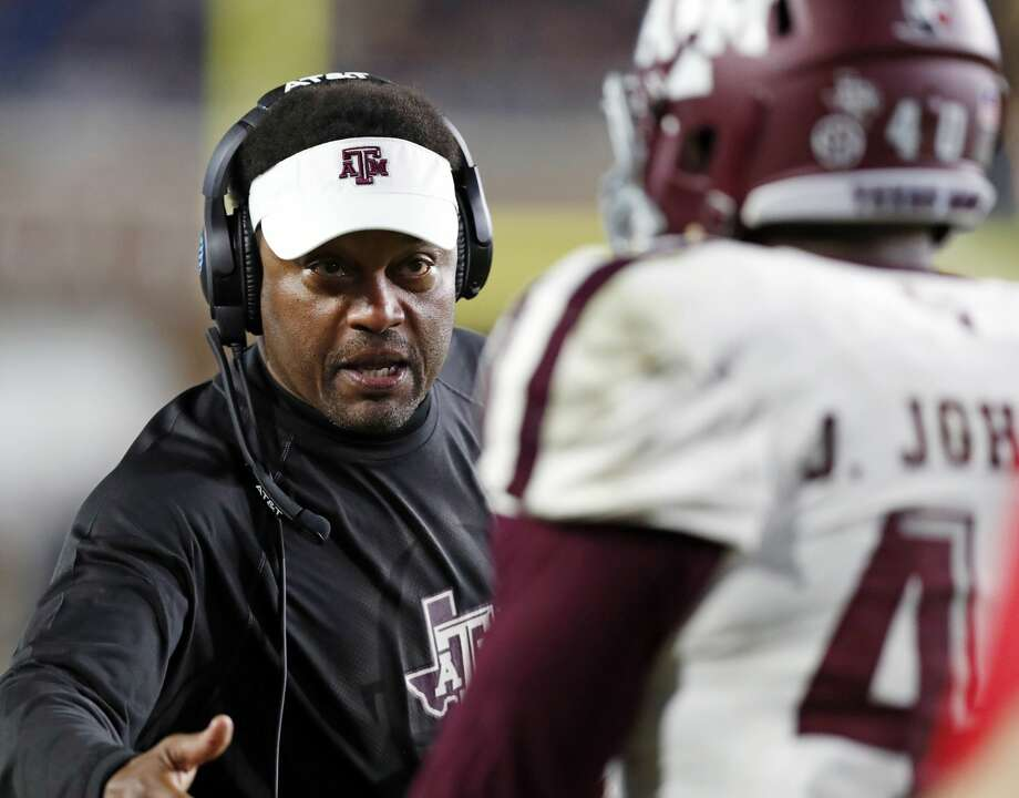 Texas A&M head coach Kevin Sumlin congratulates defensive lineman Jarrett Johnson (40) for helping stop Mississippi from getting a first down during the second half of an NCAA college football game in Oxford, Miss., Saturday, Nov. 18, 2017. Texas A&M won 31-24. (AP Photo/Rogelio V. Solis) Photo: Rogelio V. Solis/Associated Press