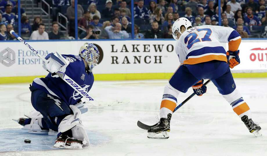 New York Islanders left wing Anders Lee (27) slips the puck past Tampa Bay Lightning goalie Andrei Vasilevskiy (88) for a goal during the third period of an NHL hockey game Saturday, Nov. 18, 2017, in Tampa, Fla. The Islanders won the game 5-3. (AP Photo/Chris O'Meara) ORG XMIT: TPA112 Photo: Chris O'Meara / Copyright 2017 The Associated Press. All rights reserved.