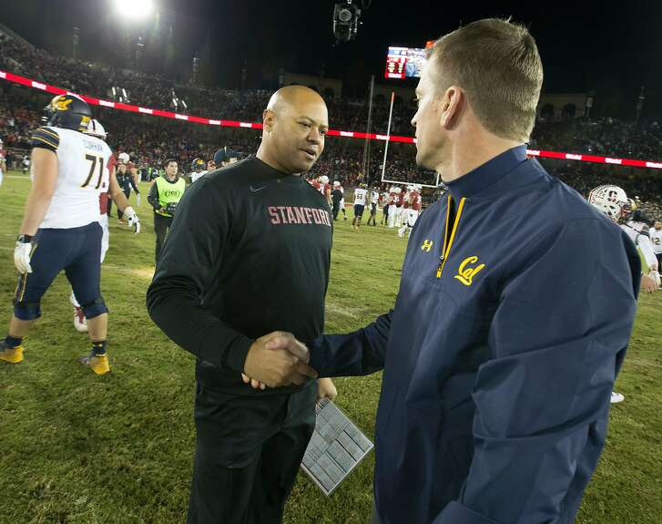 Stanford head coach David Shaw, left, shakes hands with California head coach Justin Wilcox following the 120th Big Game,  Saturday, Nov. 18, 2017 in Stanford, Calif. Stanford won, 17-14.
