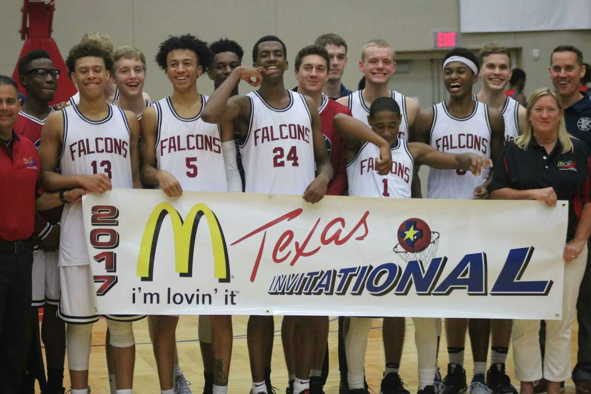 The Katy Tompkins basketball team rejoices after winning the boys division Saturday night, following the 59-54 win over Duncanville.