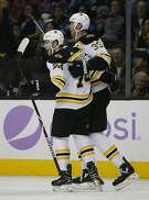Boston Bruins left wing Jake DeBrusk (74) celebrates after scoring a goal with teammate Zdeno Chara (33), of Slovakia, against the San Jose Sharks during the first period of an NHL hockey game Saturday, Nov. 18, 2017, in San Jose, Calif. (AP Photo/Tony Avelar)