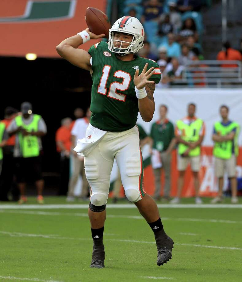 MIAMI GARDENS, FL - NOVEMBER 18:  Malik Rosier #12 of the Miami Hurricanes passes during a game against the Virginia Cavaliers at Hard Rock Stadium on November 18, 2017 in Miami Gardens, Florida.  (Photo by Mike Ehrmann/Getty Images) ORG XMIT: 775053190 Photo: Mike Ehrmann / 2017 Getty Images