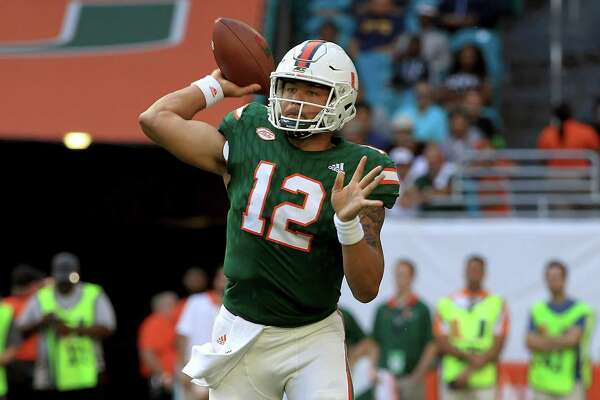 MIAMI GARDENS, FL - NOVEMBER 18:  Malik Rosier #12 of the Miami Hurricanes passes during a game against the Virginia Cavaliers at Hard Rock Stadium on November 18, 2017 in Miami Gardens, Florida.  (Photo by Mike Ehrmann/Getty Images) ORG XMIT: 775053190