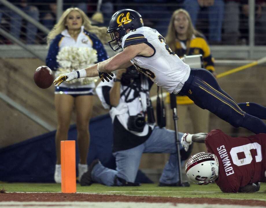 Cal running back Patrick Laird fumbles out of bounds at the one-yard-line as he's brought down by Stanford's Ben Edwards. Photo: D. Ross Cameron / D. Ross Cameron / Special To The Chronicle / online_yes