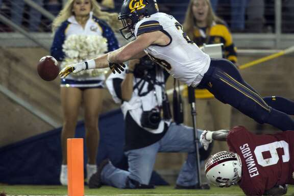 Cal running back Patrick Laird fumbles out of bounds at the one-yard-line as he's brought down by Stanford's Ben Edwards.