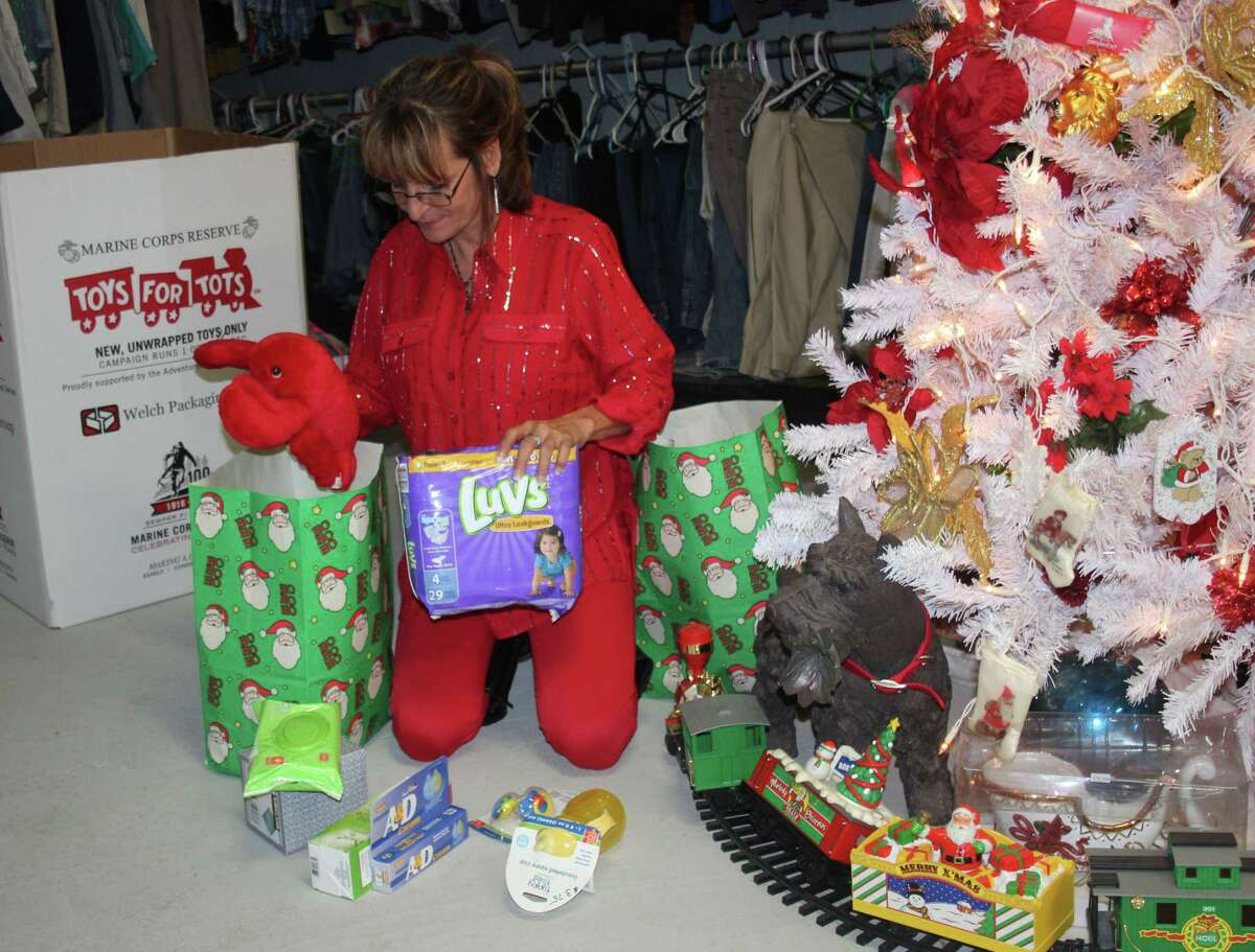 Community and Children's Impact Center Executive Director Brenda Myers loads up supplies in a bag intended to be given to the local homeless and needy both in and out of San Jacinto County.