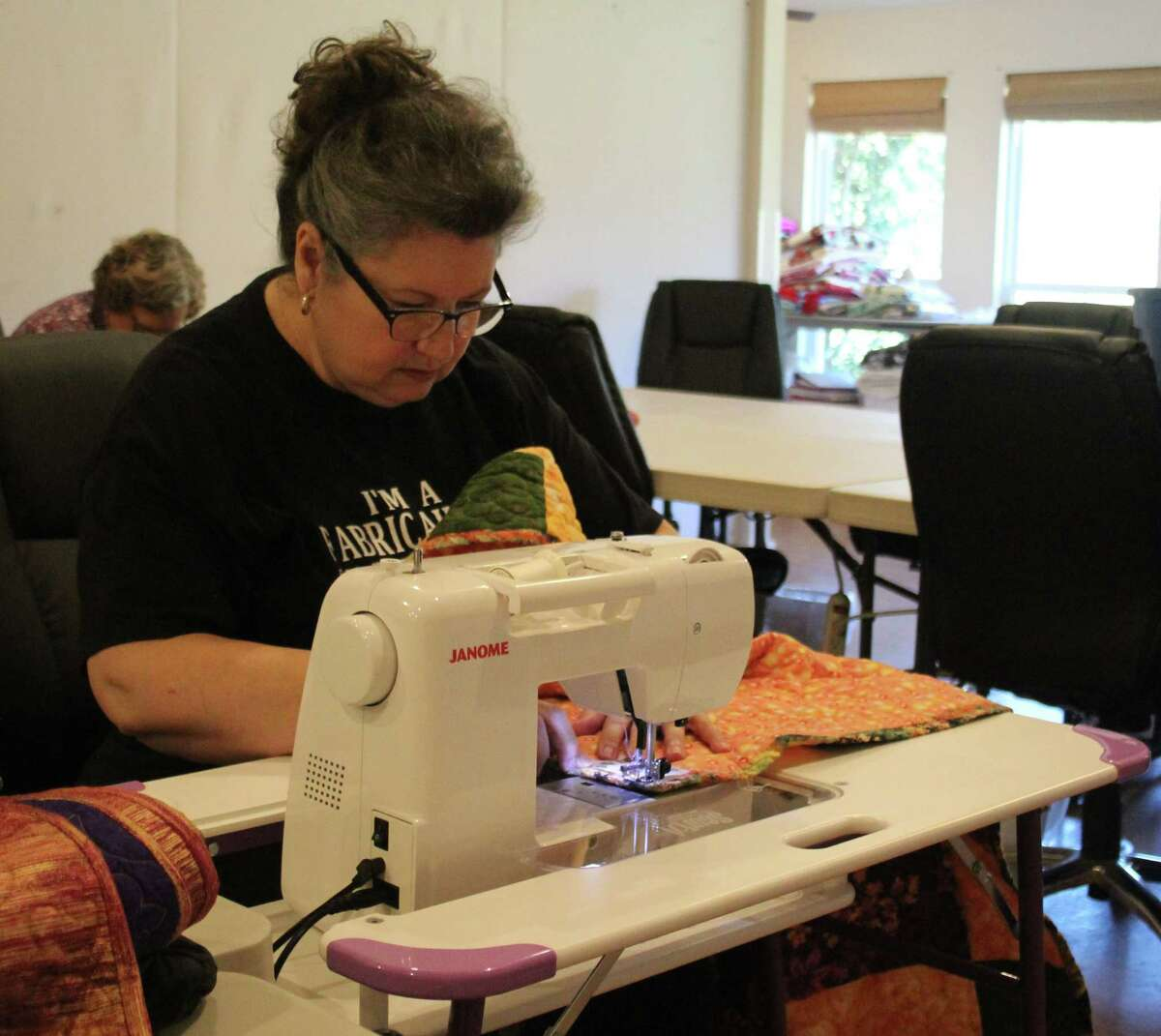 Karen Lee works on a new quilt to be given out to a needy child.