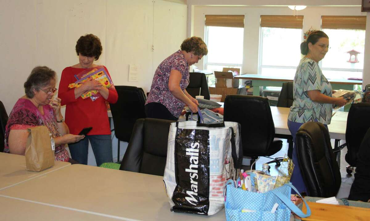 Members of the Coldspring chapter of Quilts for Kids work diligently to create quilts for children in need of comfort, which includes children unable to return to their homes after the flooding of Hurricane Harvey.