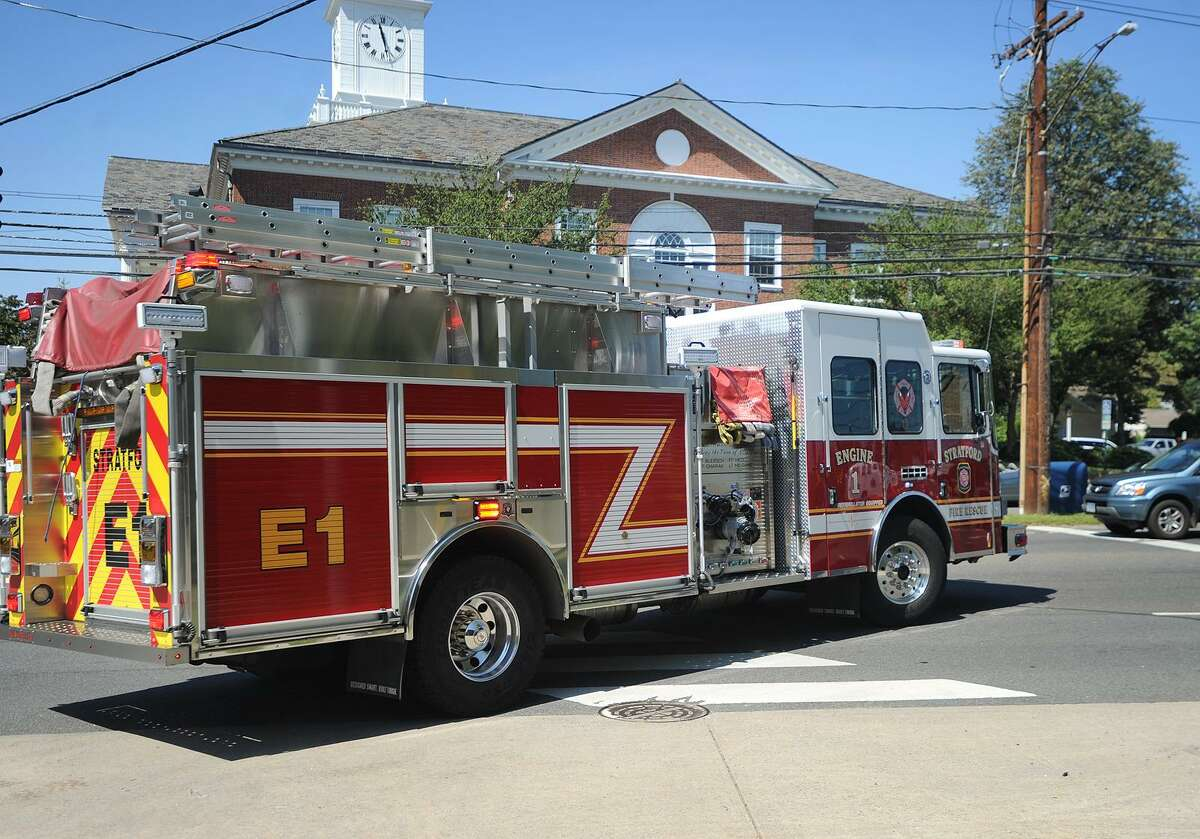 File photo of a truck exiting Stratford Fire Headquarters on a medical call in Stratford, Conn. on Thursday, August 17, 2017.