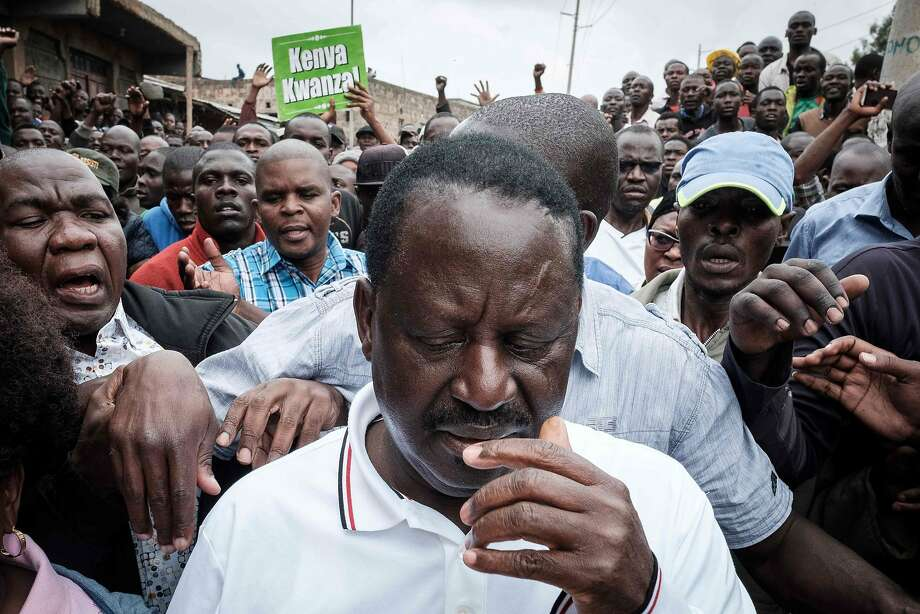Raila Odinga, head of Kenya's opposition party, visits a Nairobi district torn by election turmoil. Photo: YASUYOSHI CHIBA, AFP/Getty Images