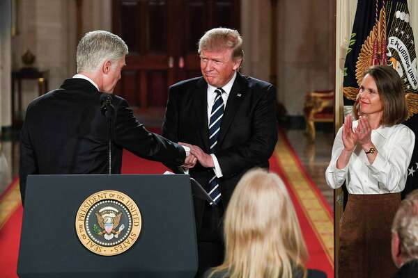 President Donald Trump greets Judge Neil M. Gorsuch during his announcement of Gorsuch's Supreme Court nomination in Washington, D.C., on Jan. 31, 2017.