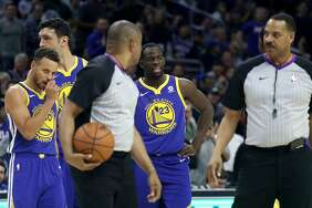 Draymond Green #23 of the Golden State Warriors talks with officials after getting called for a technical foul in the first half against the Philadelphia 76ers at Wells Fargo Center on November 18, 2017 in Philadelphia,Pennsylvania.