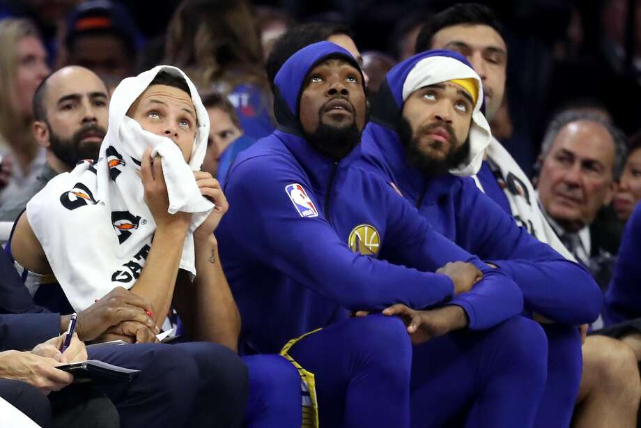 PHILADELPHIA, PA - NOVEMBER 18: Stephen Curry #30 (L), Kevin Durant #35 (C), and JaVale McGee #1 of the Golden State Warriors look on from the bench in the first half against the Philadelphia 76ers at Wells Fargo Center on November 18, 2017 in Philadelphia,Pennsylvania. NOTE TO USER: User expressly acknowledges and agrees that, by downloading and or using this photograph, User is consenting to the terms and conditions of the Getty Images License Agreement. (Photo by Rob Carr/Getty Images) Photo: Rob Carr, Getty Images