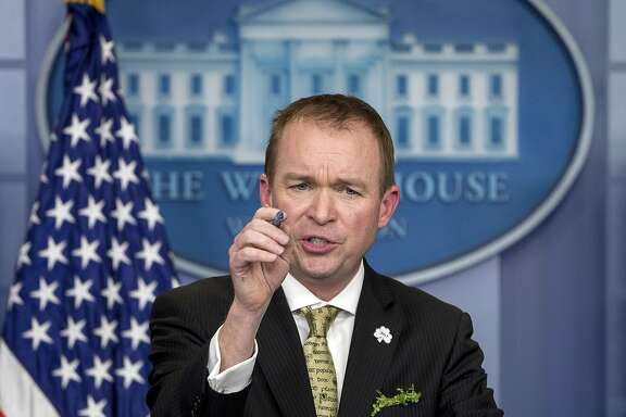 FILE - In this March 16, 2017, file photo, White House budget director Mick Mulvaney speaks at the White House, in Washington. Mulvaney says that Democratic negotiators on a massive spending bill need to agree to funding top priorities of President Donald Trump, such as a down payment on a border wall and hiring of additional immigration agents. Mulvaney told The Associated Press on April 20, that �elections have consequences� and that �we want wall funding� as part of the catchall spending bill, which lawmakers hope to unveil next week. (AP Photo/Andrew Harnik, file)