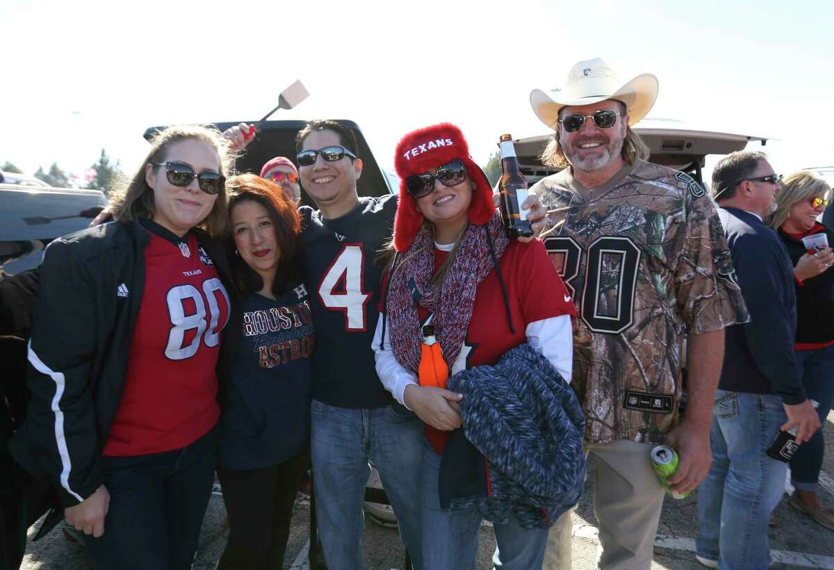Houston Texans fans pose for a photo before the team takes on Arizona Cardinals at NRG Stadium on Sunday, Nov. 19, 2017, in Houston.