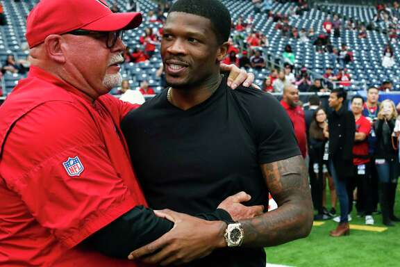 Arizona Cardinals head coach Bruce Arians embraces former Houston Texans wide receiver Andre Johnson before an NFL football game at NRG Stadium on Sunday, Nov. 19, 2017, in Houston.