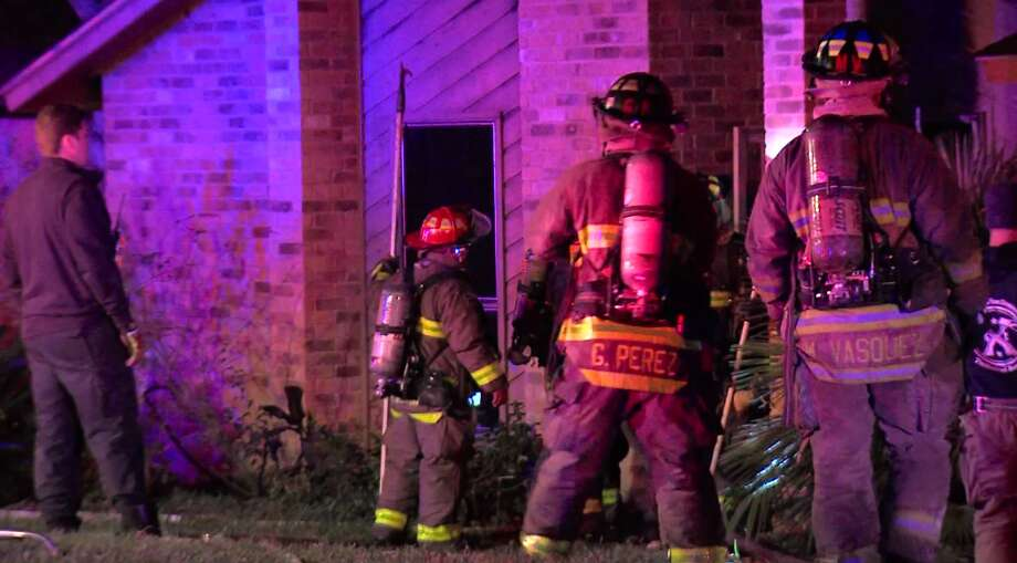 San Antonio firefighters rescued two children from a burning home Sunday morning, Nov. 19, 2017, on the Northwest Side. Photo: 21 Pro Video