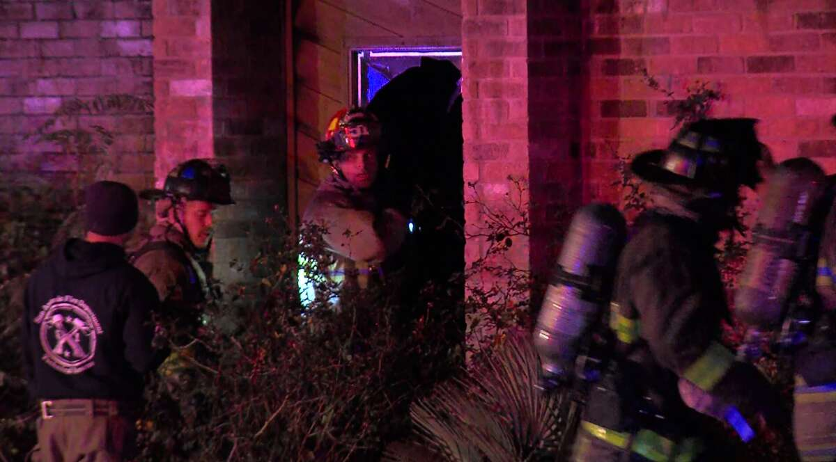 San Antonio firefighters rescued two children from a burning home Sunday morning, Nov. 19, 2017, on the Northwest Side.
