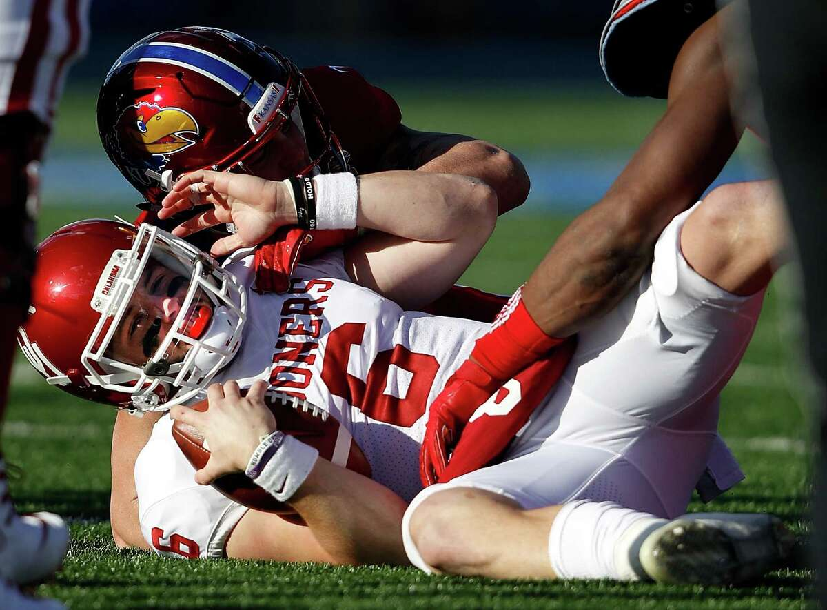 Oklahoma quarterback has made a habit of apologizing this year. His latest apology came Saturday after he grabbed his crotch and shouted an obscenity at the Kansas sideline.