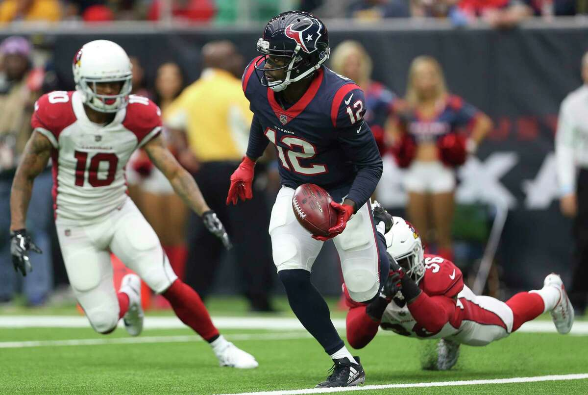 Houston Texans wide receiver Bruce Ellington (12) picks up and runs the ball after it was downed by Arizona Cardinals safety Budda Baker (36) at one-yard line during the first quarter of a NFL game at NRG Stadium on Sunday, Nov. 19, 2017, in Houston.