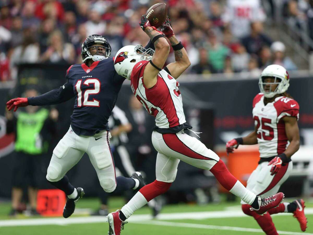 Arizona Cardinals free safety Tyrann Mathieu (32) almost intercept a pass from Houston Texans quarterback Tom Savage (3) to wide receiver Bruce Ellington (12) during the first quarter of a NFL game at NRG Stadium on Sunday, Nov. 19, 2017, in Houston.