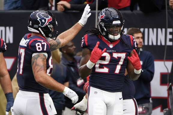 Houston Texans running back D'Onta Foreman (27) celebrates with teammates after a touchdown run during the second half of an NFL football game against the Arizona Cardinals, Sunday, Nov. 19, 2017, in Houston. (AP Photo/Eric Christian Smith)