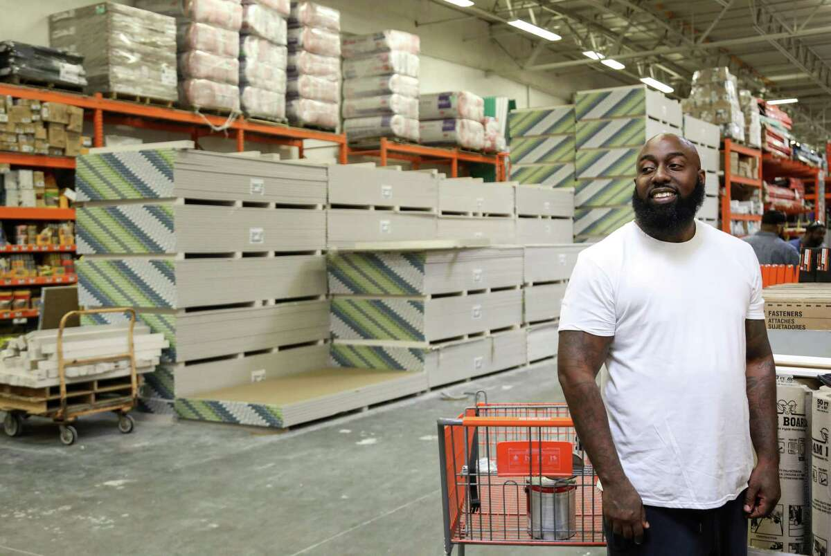 """Frazier Thompson, III, who goes by his stage name, """"Trae the Truth,"""" smiles at a fan as he waits to buy building supplies at a hardware store, Monday, Nov. 6, 2017, in Houston."""