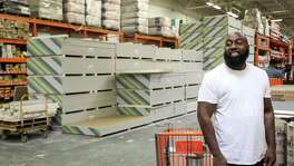 "Frazier Thompson, III, who goes by his stage name, ""Trae the Truth,"" smiles at a fan as he waits to buy building supplies at a hardware store, Monday, Nov. 6, 2017, in Houston."