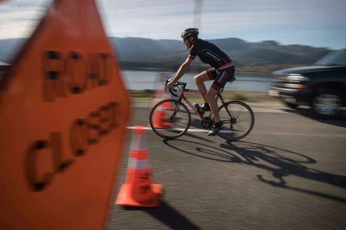 Bicyclists participate in Bicycle Sunday in San Mateo County at Ca�ada Road adjacent to Crystal Springs Reservoir where roads are cleared to cars between the Filoli entrance and Highway 92, allowing jogging, bicycling, hiking, roller-skating, and walking on Sunday, Nov. 19, 2017 in Belmont, CA