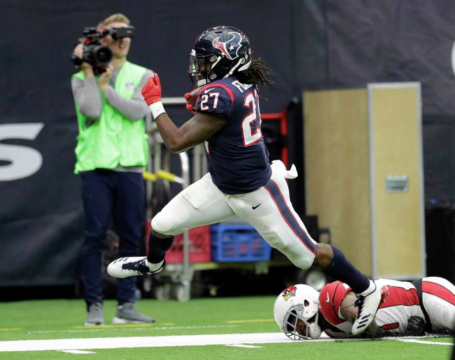 Houston Texans running back D'Onta Foreman (27) scores on a 34-yard run during the second half of an NFL football game against the Arizona Cardinals, Sunday in Houston. Foreman was injured on the play. Photo: David J. Phillip, STF / Copyright 2017 The Associated Press. All rights reserved.