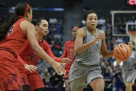 UConn's Napheesa Collier, right, dribbles past a pair of Maryland defenders in the second half on Sunday.