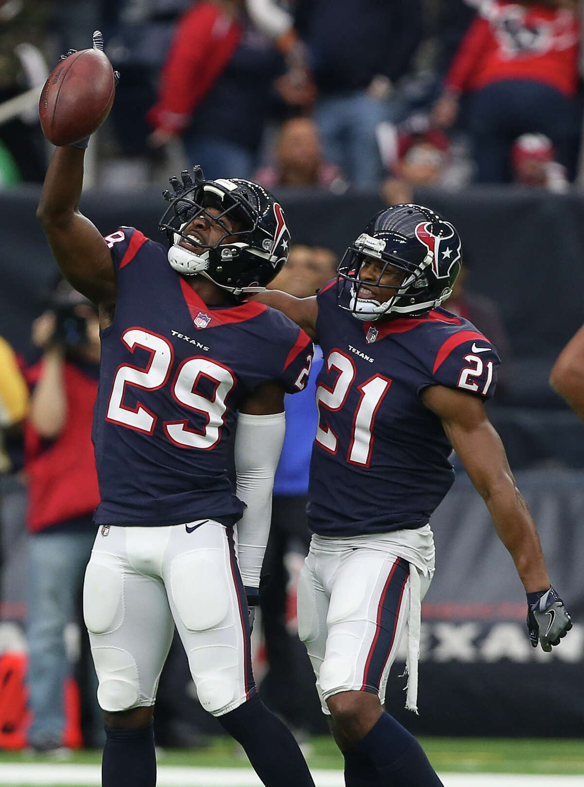 Houston Texans strong safety Marcus Gilchrist (21) joins Andre Hal (29) to celebrate Hal's interception during the fourth quarter of a NFL game against the Arizona Cardinals at NRG Stadium on Sunday, Nov. 19, 2017, in Houston. The Houston Texans defeated the Arizona Cardinals 31-21.