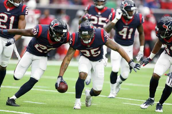 Houston Texans defensive back Eddie Pleasant (35) celebrates with Andre Hal (29) after his interception of a pass intended for Arizona Cardinals wide receiver Brittan Golden (10) during the fourth quarter of an NFL football game at NRG Stadium,  Sunday, Nov. 19, 2017, in Houston.