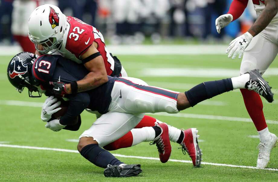 Houston Texans wide receiver Braxton Miller (13) is tackled by Arizona Cardinals free safety Tyrann Mathieu (32) during the first quarter of an NFL football game at NRG Stadium on Sunday, Nov. 19, 2017, in Houston. Photo: Brett Coomer, Houston Chronicle / © 2017 Houston Chronicle