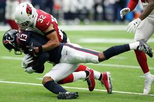 Houston Texans wide receiver Braxton Miller (13) is tackled by Arizona Cardinals free safety Tyrann Mathieu (32) during the first quarter of an NFL football game at NRG Stadium on Sunday, Nov. 19, 2017, in Houston.