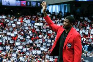 Former Houston Texans wide receiver Andre Johnson waves to the fans as he is honored as the first Texans player in the Ring of Honor during the halftime celebration at NRG Stadium on Sunday, Nov. 19, 2017, in Houston.