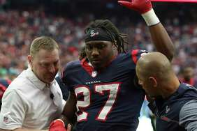 Houston Texans running back D'Onta Foreman (27) waves at the fans as he is getting up with help from paramedics during the fourth quarter of a NFL game against the Arizona Cardinals at NRG Stadium on Sunday, Nov. 19, 2017, in Houston. The Houston Texans defeated the Arizona Cardinals 31-21.