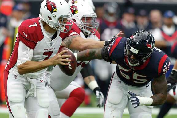 Arizona Cardinals quarterback Blaine Gabbert (7) is chased out of the pocket by Houston Texans inside linebacker Benardrick McKinney (55) during the second quarter of an NFL football game at NRG Stadium on Sunday, Nov. 19, 2017, in Houston.