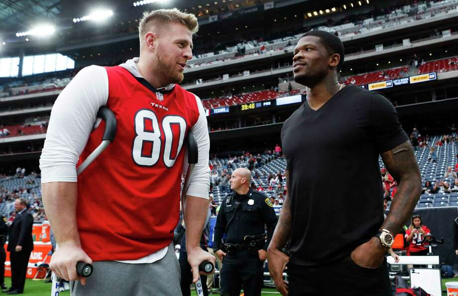 Houston Texans defensive end J.J. Watt, left, talks to former Texans wide receiver Andre Johnson before an NFL football game at NRG Stadium on Sunday, Nov. 19, 2017, in Houston. ( Brett Coomer / Houston Chronicle ) Photo: Brett Coomer, Staff / © 2017 Houston Chronicle