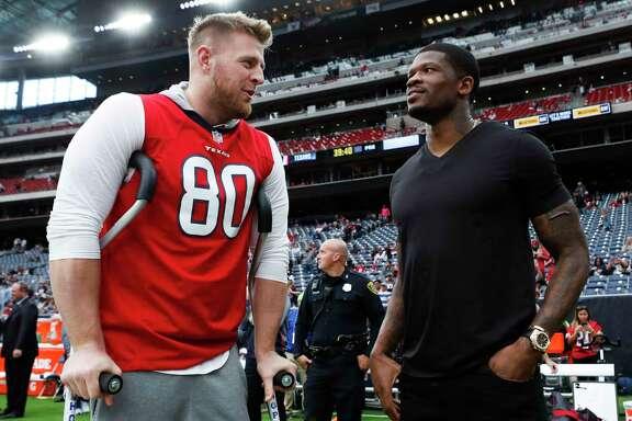 Houston Texans defensive end J.J. Watt, left, talks to former Texans wide receiver Andre Johnson before an NFL football game at NRG Stadium on Sunday, Nov. 19, 2017, in Houston. ( Brett Coomer / Houston Chronicle )