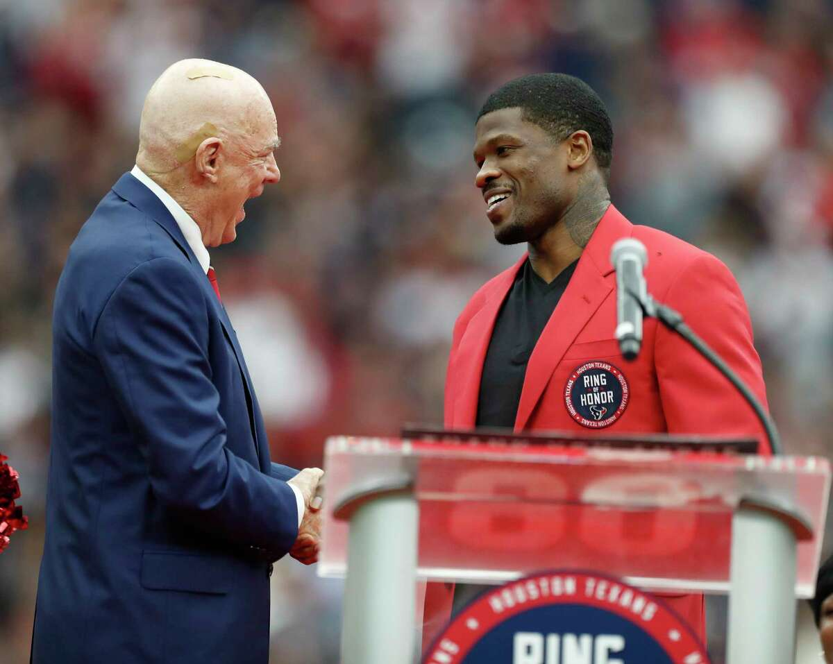 Andre Johnson is greeted by Houston Texans owner Bob McNair as Johnson was celebrated during his Ring of Honor ceremony during halftime of an NFL football game at NRG Stadium, Sunday, Nov. 19, 2017, in Houston. ( Karen Warren / Houston Chronicle )