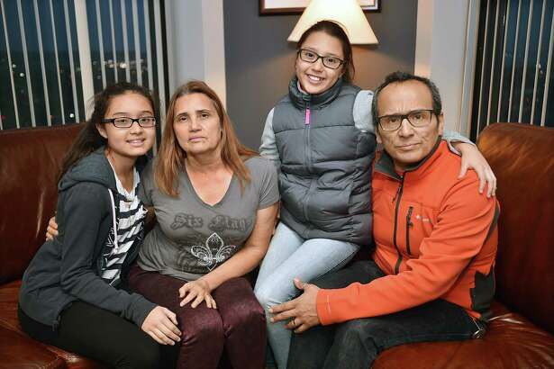 Miriam Martinez, 53, a Stamford mother facing deportation to Guatemala with her husband Raphael Benavides, 46, and their daughters Brianna Benavides, 12, at left, and her 10-year-old sister Allison Benavides are photographed, Saturday, Nov. 18, 2017, at the New Haven office of their attorney, Glenn Formica.