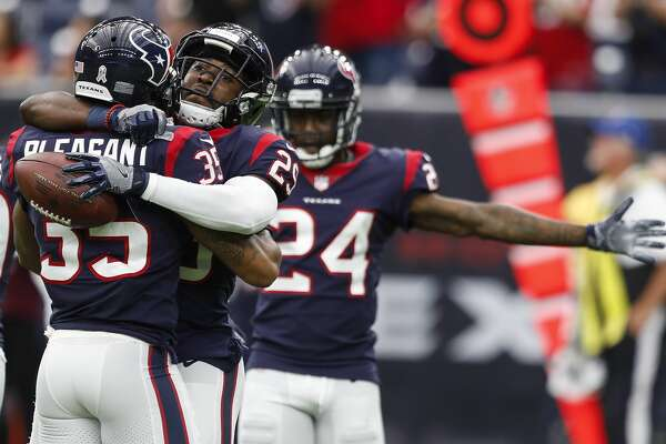 Houston Texans free safety Andre Hal (29) embraces defensive back Eddie Pleasant (35) as they celebrate Hal's interception of a pass by Arizona Cardinals quarterback Blaine Gabbert during the fourth quarter of an NFL game at NRG Stadium on Sunday, Nov. 19, 2017, in Houston. ( Brett Coomer / Houston Chronicle )