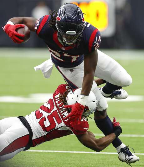 Houston Texans running back D'Onta Foreman (27) is hit by Arizona Cardinals defensive back Tramon Williams (25) during the fourth quarter of an NFL game at NRG Stadium on Sunday, Nov. 19, 2017, in Houston. ( Brett Coomer / Houston Chronicle ) Photo: Brett Coomer/Houston Chronicle