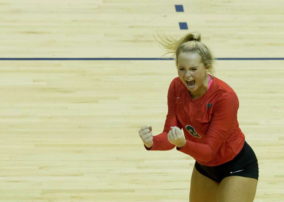 The Woodlands setter Sophie Walls (8) celebrates a point during the second set of a Region II-6A semifinal volleyball match at Johnson Coliseum, Friday, Nov. 10, 2017, in Huntsville. Photo: Jason Fochtman, Staff Photographer / © 2017 Houston Chronicle