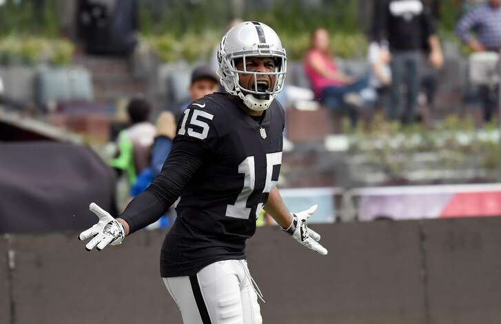 Oakland Raiders' Michael Crabtree gestures against the referee during the 2016 NFL week 11 regular season football game against New England Patriots on November 19, 2017 at the Azteca Stadium in Mexico City. / AFP PHOTO / ALFREDO ESTRELLAALFREDO ESTRELLA/AFP/Getty Images